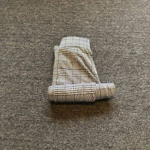 How to roll pants into a packing cube